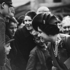 The Queen Mother talking to youngsters in London's East End during a tour of areas damaged by Luftwaffe air raids.