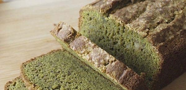 """a sliced loaf of gluten free matcha green tea banana bread"""