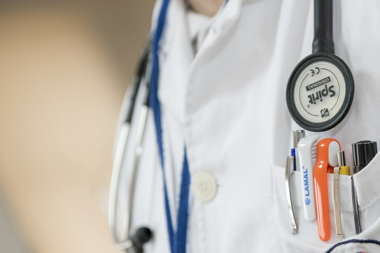"""doctor's white coat with stethoscope and pens in pocket - healthscare"""