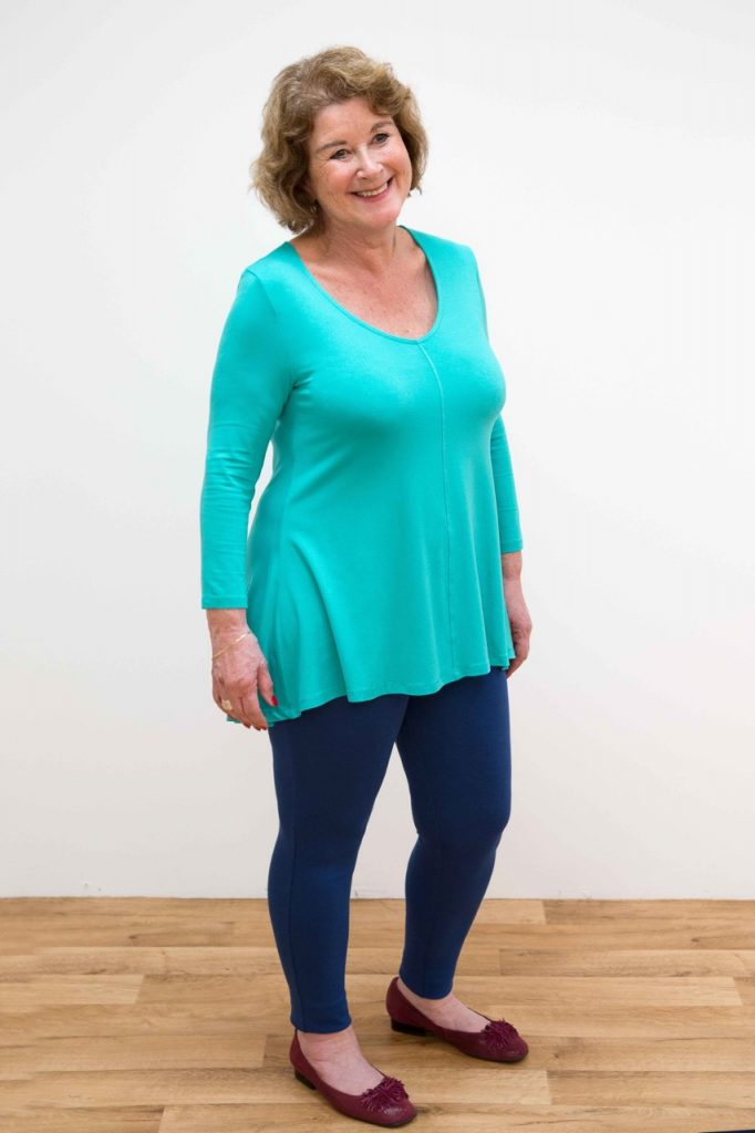 A woman in a bright turquoise top and leggings / How to dress a pear shaped body / Fashion / The CountryWives