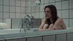 A woman in the bath in Tabula Rasa TV series / What to do when Spring has not sprung! / Don't Miss This / The CountryWives