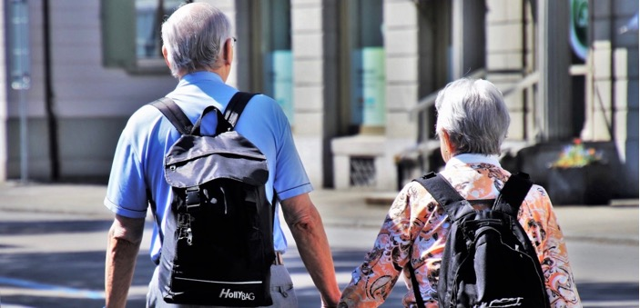 Relationships / elderly couple with backpacks holding hands / Zeynep / Blog / The CountryWives