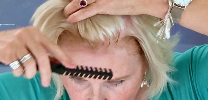 Annabel applying Josh Wood root concealer