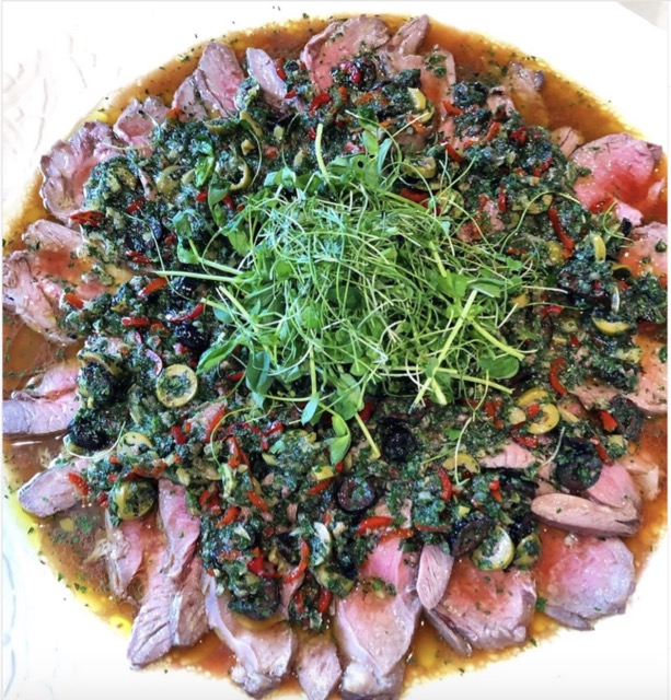Plate of Butterflied Lamb with preserved Lemon Olive Anchovy Chilli & Mint Drizzle