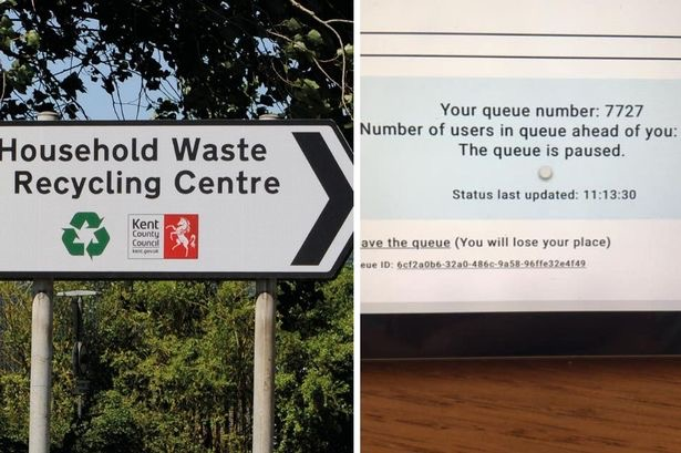 Signs for a queue for the recycling centre