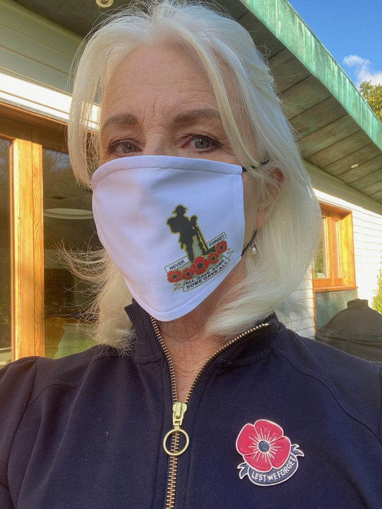 Annabel wears her mask and poppy pin in honour of Remembrance Sunday during No-go-vember